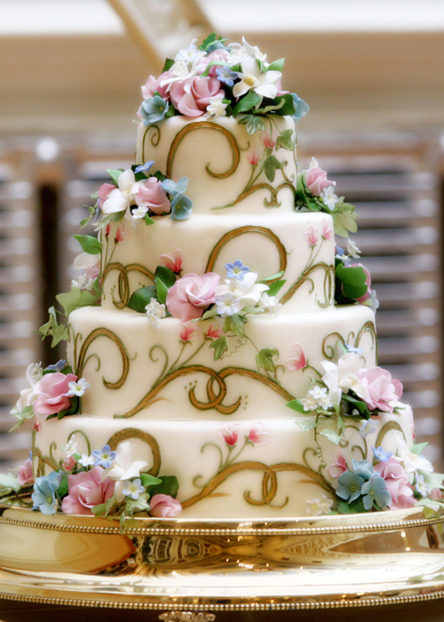 A fairytale wedding gilded swirls become the perfect backdrop for a